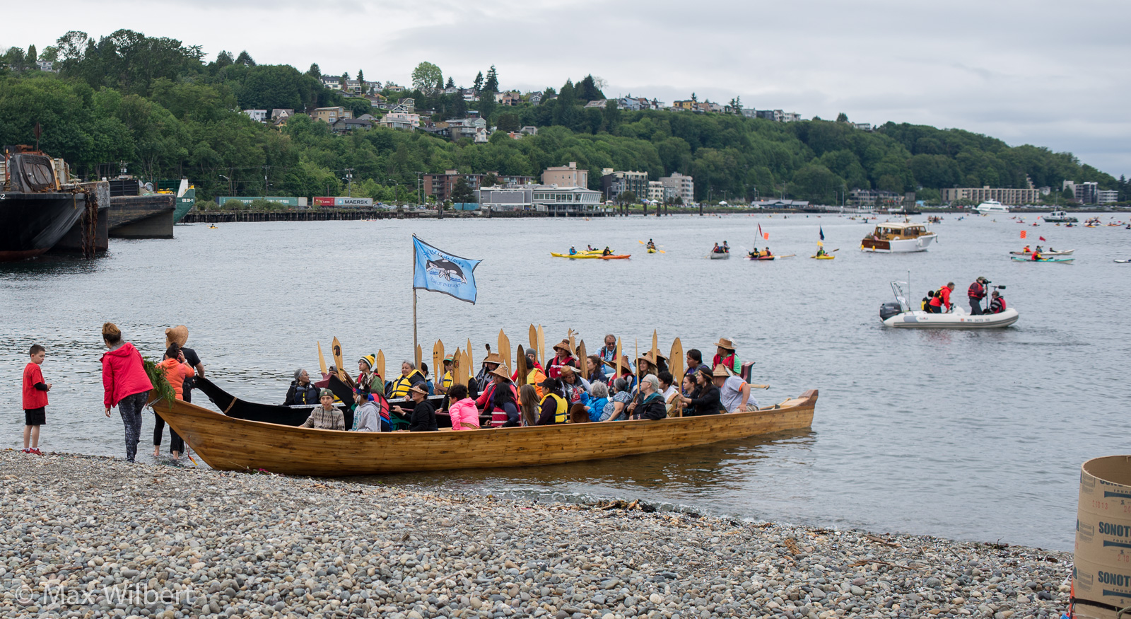 Members of the Duwamish, Lummi, and other local nations in beautiful traditional canoes.